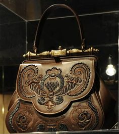 """As a tribute to the city of Florence, a city that has long been famous for its exquisite leather work, fashion house Gherardini has brought Leonardo's handbag to life. Designer Carla Braccialini designed the """"Pretiosa"""" (meaning """"precious"""" and yes, I am saying it like Gollum) bag based on Leonardo's drawing, and artisans made it by hand using luxury materials like embroidered calf leather and an embossed brass handle."""