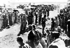 American soldiers line up as they surrender their arms to the Japanese at the naval base of Mariveles on Bataan Peninsula in the Philippines in April of 1942. (AP Photo)