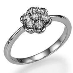 0.40 carats Round Cut Diamond Engagement Ring 14k White Gold Flower Shape. $609.00, via Etsy.