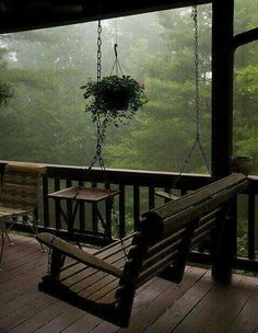 Imagine waking up in a cozy cabin in the mountains and walking out into this porch with hot tea in hand, inhaling the fresh smell of an early morning rain :) Peaceful. ~ yes, i want a porch like this and a swing. I always love sitting on the porch. Outdoor Spaces, Outdoor Living, Outdoor Decor, Outdoor Kitchens, Cozy Room, Cabins In The Woods, House In The Woods, My Dream Home, Dream Homes