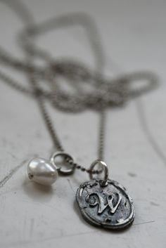 Handmade letter pendant. I had a necklace with the letter A.. it broke a long time ago.<3
