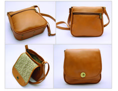 TOBACCO FLAP. EXTERIOR: Made of light-brown Cowhide Leather. Antique brass round turn lock. Metal-nished zippers. Rectangular metal rings. External zipper pocket. Antique brass metal studs. INTERIOR: Printed lining. One Pocket for cell. phone or glasses One zipper pocket.