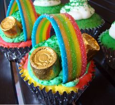 Saint Patrick's Day cupcakes!!! Xtreme sour belts, chocolates covered in gold wrapping, and of course the rainbow cupcakes!!!