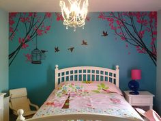 Elyse's redecorated bedroom. Someone wanted to see it for a girly girls room. IKEA chandelier and sticker mural from ebay