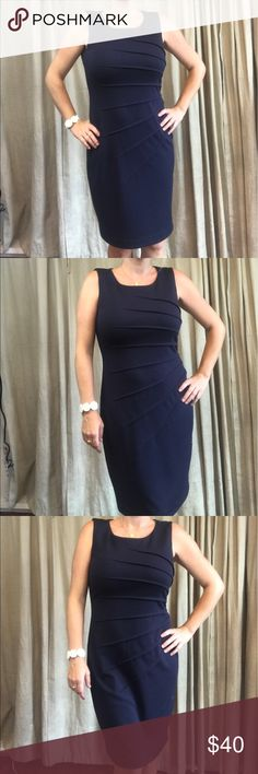 Sunburst navy blue Calvin Klein dress Great for the office or a cocktail party.  Sunburst pattern on side. Very slimming and flattering, made from a thick jersey. Lined. Zips up back, neckline is high in back. Calvin Klein Dresses