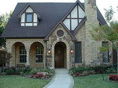 The Victoria Tudor house plan is the epitome of elegance accented by a stone & b.The Victoria Tudor house plan is the epitome of elegance accented by a stone & brick facade. This narrow floor plan is perfect for a small lot in the city. Small Cottage Homes, Cottage Style Homes, Cottage House Plans, Rural House, Cottage House Styles, Stone Cottage Homes, Stone Homes, Metal Homes, Style At Home