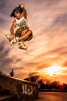 Skater courageously jumping off the stairs at beautiful sunset in Stoke on Trent skatepark.