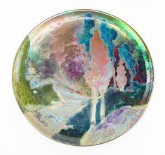 """Clement Massier (French, 1844-1917) A Charger. Hand decorated glazed ceramic charger depicts a pastoral scene with trees in a Fauvist style setting. Reverse is incised """"Clement Massier Golfe - Juan (A.M.)"""" Diameter: 16"""""""