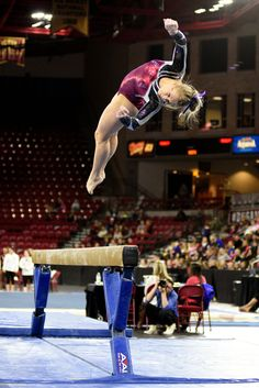 University of Denver gymnast Julia Ross dismounts the beam. Photo taken on March 7, 2015, in Magness Arena at DU.