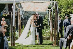 Rustic chuppah with hand dyed cover