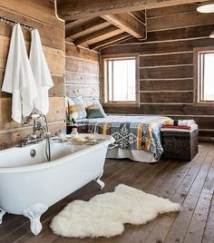 A bathtub in your bedroom. Simple and super comfy! Wouldnt be finished without wooden paneled flooring of course ;)