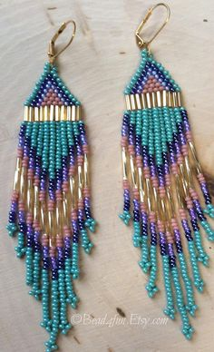 Name: Ya Ya Sisters long Beaded Earrings, Fringe Beaded Earrings, Seed Bead Earrings, Gypsy, Statement Earrings Size: 5 inches long ( with hooks) 1 inch wide Colors: Luster turquoise, pink, purples, Gold These earrings are my original design and hand woven by me; they are truly