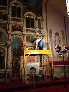 ICA conservator cleaning the iconstasis (painted screen) at Holy Ghost Byzantine Catholic Church in Cleveland's Tremont neighborhood