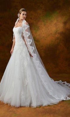 Abiti da sposa stile principessa modello Janet confezionato in tulle con ricami in pizzo