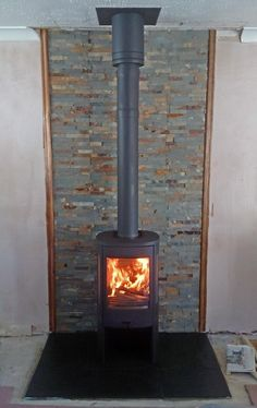 A Contura stove in grey with a Poujoulat twin wall flue system painted grey to match the wood burner Wood Stove Surround, Wood Stove Hearth, Log Burner Fireplace, Wood Burner, Stone Tile Fireplace, Fireplace Tv Wall, Fireplace Surrounds, Fireplace Ideas, Wood Stove Heat Shield