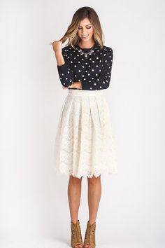 We are obsessed with our newest midi skirt! In a gorgeous lace pattern and detailing throughout, this skirt is the essential piece to complete your feminine look. With an A-line flair and pockets, (ye