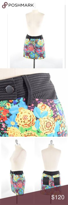 """Balenciaga bright floral stretch Denim mini skirt Stun in this bright floral stretch cotton denim mini skirt from Balenciaga. Authentic, made in Italy. Colorful floral pattern in hot pink, blue, and yellow. Contrast black & gray stripe at waist and pockets. Soft, stretch cotton denim. Italian size 38, US size 4, fits a 2/4 best. Length: 16"""" Waist: 30"""" Hip: 35"""" Balenciaga Skirts Mini"""