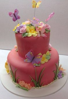 Cute first birthday cake with butterflies and flowers
