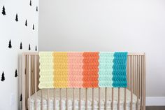 Put a modern twist on the traditional ripple afghan with this gender-neutral crochet baby blanket pattern! This free ripple pattern is easy and rewarding.