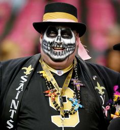 A New Orleans Saints fan looks on before a game against the Dallas Cowboys - Jonathan Bachman/AP