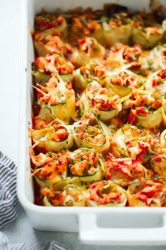 4-Ingredient Chicken Zucchini Rolls - cooked shredded skinless chicken breast, store-bought/homemade spaghetti/marinara/tomato sauce (she links a recipe option), zucchini, shredded mozzarella (might sub another cheese &/or reduce)
