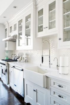 farmhouse-kitchen-sink-traditional-cococozy Love white farmhouse sink with sound dampening pads. High arm faucet is perfect for filling pots. Like the white upper but prefer med/dark blue or grey blue for bottoms. Not sure about backsplash