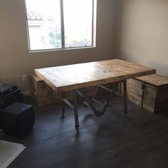 We built this table with a base that was custom welded from an old rusted ladder. The crates in this picture were from the 1940's and used to ship Russian gas masks. #woodwork #design #interiordesign #woodworking #interiordesigns #interiordesigners #interiordesignideas #architectural #reclaimedwood #reclaimed #woodwork #craftsman #happycustomers #losangeles #la #upcycle #salvaged #antique