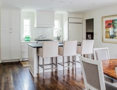Sarah Spinosa splurged on a slab of Calacatta marble for her kitchen backsplash, using less expensive honed granite on the island countertop. The result? Maximum visual bang for the buck.