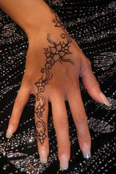 Beautiful hand tattoo with jewels-  I had something like this done at BookExpo in LA and hated that it faded.  I wanted a tat for my 70th and didn't get one.  This may be the one!!!!!!!!!!  It is so graceful and feminine - in henna colored ink?