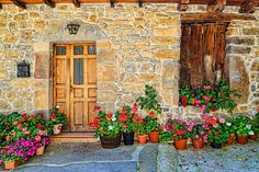 Cambarco, a small village in the cantabrian region of Spain, Los Picos de Europa, a historical town.  A beautiful inviting front door. #Spaintravel