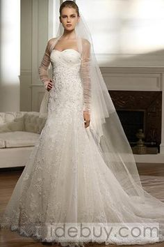 Beautiful gown with net sleeves that match the veil!  #weddinggowns #weddingdresses