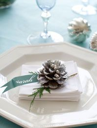 Sparkling Pinecones: Dress up a simple place setting with a pinecone and name tag cut from scrapbook paper and attached to a whitewashed pinecone studded with silver dragees.