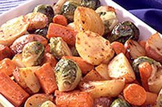 Market-fresh vegetables—carrots, potatoes, onions and Brussels sprouts—get roasted till tender in this tasty side dish.  KRAFT Dressing transforms these harvest veggies into a tasty, simple side.
