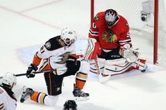 CHICAGO, IL - MAY 27: Corey Crawford #50 of the Chicago Blackhawks makes a save in the first period as Kyle Palmieri #21 of the Anaheim Ducks looks for a rebound in Game Six of the Western Conference Finals during the 2015 NHL Stanley Cup Playoffs at the United Center on May 27, 2015 in Chicago, Illinois. (Photo by Tasos Katopodis/Getty Images)
