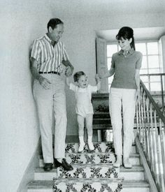 """The actress Audrey Hepburn photographed with her husband Mel Ferrer (actor, dialogue coach and film director) and their son Sean H. Ferrer by Pierluigi Praturlon at """"Villa Bethania"""", their charming villa in Bürgenstock (Switzerland), in June 1962.Audrey was wearing:Polo shirt: Lacoste (of cotton pique in a shade of brown, purchased by Audrey in 1962)."""