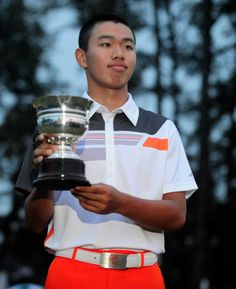 Tianlang Guan, the only amateur to make the cut, received the trophy for low amateur in his first Masters Tournament.