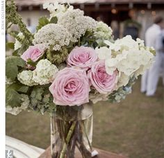Jars filled with garden roses, wildflowers, and peonies kept the centerpieces sweet and simple.