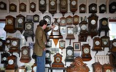 Horologist Roman Piekarski starts the time consuming task of adjusting the 600 antique clocks at Cuckooland Museum