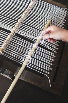 I've had a few questions lately about how to set up a heddle rod. When I was first learning how to weave, I searched for a heddle tutorial high and low and couldn't find anything! I had to do some experimenting before I understood exactly what they were. See those two dowels at the top of