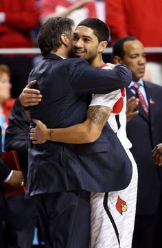 LEXINGTON, KY - MARCH 23: Peyton Siva #3 of the Louisville Cardinals hugs head coach Rick Pitino after defeating the Colorado State Rams during the third round of the 2013 NCAA Mens Basketball Tournament at Rupp Arena on March 23, 2013 in Lexington, Kentucky
