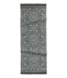 Charcoal gray. Rug in woven cotton fabric with a printed pattern at front.