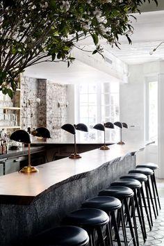 Stunning Design. Natural Wood Counter Top, scalloped floor tiles. Dark Peninsula White Upper Cabinet Display.