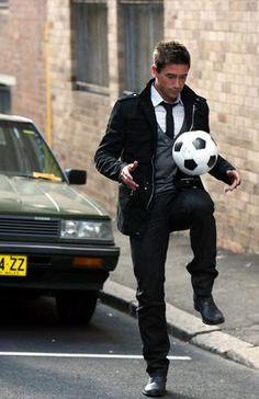 Black parka, grey cardigan, black tie; whereisthecool.com
