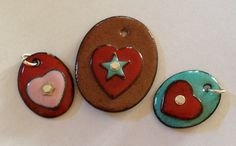 Handmade in the USA copper enamel pendant necklaces. Colored heart necklaces on oval pendants and sterling silver chain