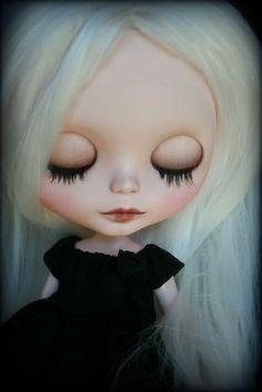 Blythe- Pale doll dressed in black.  Has platinum blonde hair.