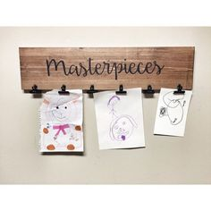 What a unique and fun way to display photos, kids drawings or notes in your home, nursery or office with a large rustic decorative walnut stained clip board.  This rustic masterpieces clip board measures 30 inches long by 5.5 wide and comes with six black clips for easy picture hanging. Also has brass plated tooth hangers on the back for easy hanging.  www.cherrytreegallery.etsy.com