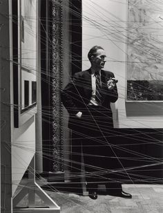 """Arnold Newman, Marcel Duchamp behind his installation of """"sixteen miles of string"""" New York, 1942 © 1942 Arnold Newman / Getty Images"""