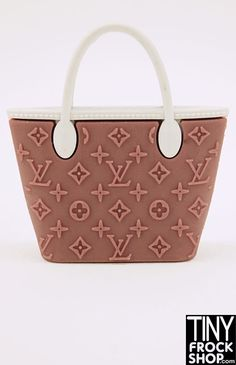 Louis Vuitton is a classic and now you can own a Louis Vuitton Classic Neverfull Bag for Barbie! In a variety of colors. With signature LV pattern. (rubber, does not open). 1:6 scale. No longer being