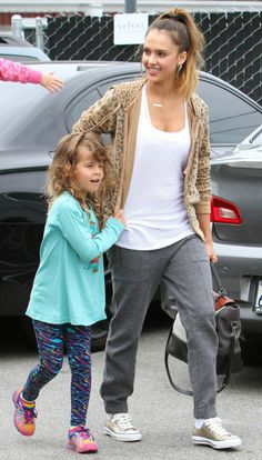 Jessica Alba wearing Converse All Star Metallic Lo Tops in Gold Jennifer Meyer Personalized Nameplate necklace Current/Elliott Leopard Hoodie Sweatshirt in Camel Leopard Diane Von Furstenberg 440 Top Handle Large Leather Satchel in Saddle/Chalk/Black J Brand Agnes Sweatshirt Pants in Medium Grey Heather The Brentwood Country Mart in Los Angeles on July 21 2013