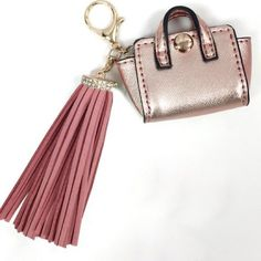 Rose Gold Mini Faux Suede Tassel Bag Charm Fashion forward trendy key item for SS16. Add interest to your bag and liven it with this mini rose gold faux suede rhinestone Tassel bag charm / key ring. Brand new never used and has tags. Melie Bianco Bags Mini Bags